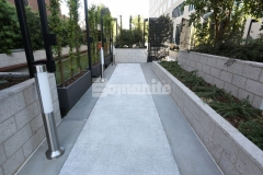 To complement the upscale architecture and design at the Emerson Luxury Apartments, Bomel Construction incorporated mother of pearl shells and Inyo white rock aggregates into this Bomanite Revealed Exposed Aggregate decorative concrete to create a hardscape with elegance and sophistication.