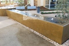 This stunning water fountain features Bomanite integrally colored concrete that was installed with a smooth trowel finish and the design and installation came together perfectly to complement the tranquil and therapeutic aesthetic in this outdoor space.