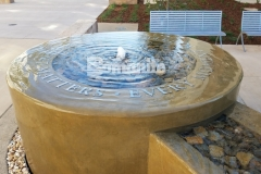 Bomanite Integral Color was paired here with a smooth trowel finish, resulting in this stunning decorative concrete fountain at the Clovis Community Medical Center that adds a tranquil, calm design feel and is perfect to remind patients and visitors that every moment matters.