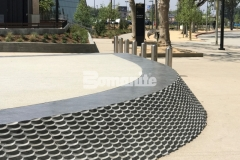 Bomel Construction Company used the Bomanite Alloy Exposed Aggregate System to create contrasting bands of decorative concrete at the LAFC Banc of California Stadium, incorporating clear glass aggregates and reflective mirror flakes to add intricate, eye-catching detail to the hardscape walkways.