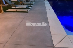 Featured here is Bomanite Revealed decorative concrete that was installed in Antique White and Slate Gray with the addition of mirror glass to create a sparkling effect on this sophisticated and durable decking surface.