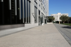 Bomel Construction expertly installed these decorative concrete walkways using Bomanite Revealed Exposed Aggregates, incorporating beautifully elegant aggregates that complement the world class architecture at the Emerson Luxury Apartments.