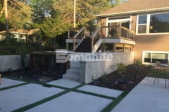 The Bomanite Antico process was expertly executed by our colleague, Concrete Arts, to create a wall cap to top these cast-in-place concrete retaining walls and the travertine-like finish is a beautiful complement to the old-world charm design in this backyard.