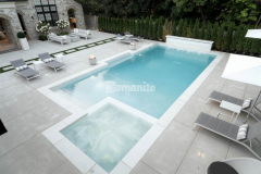 Bomanite Sandscape Refined decorative concrete was installed here to create a pool deck and patio surface that are durable and easy to maintain and add a beautiful, contemporary design element that perfectly complements the home's exterior.