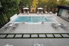Specialized concrete mix designs and advanced application procedures are utilized with the Bomanite Sandscape Refined System with the purpose of showcasing the fine aggregate and providing a distinct and durable architectural concrete finish like the one seen in this outdoor living space.