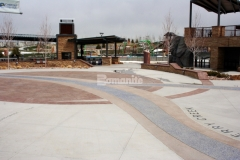 The historical facts and informational content that are beautifully displayed throughout Centennial Center Park were placed on multiple Bomanite Systems including Bomanite Imprint Systems and Bomanite Exposed Aggregate Systems and this decorative concrete backdrop was skillfully installed by our associate Premier Concrete Services and earned them the 2019 Bronze Award for Best Bomanite Exposed Aggregate Project under 6,000 SF.