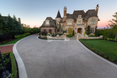 This homeowner's awe-inspiring home features a stunning, Bomanite Sandscape Texture decorative concrete driveway surface that will provide durability and easy maintenance for the homeowners while complementing the design aesthetic.