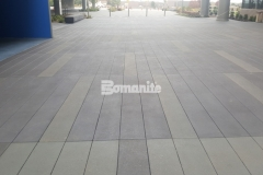 Sandscape Texture decorative concrete by Bomanite was the product of choice to create a beautifully distinctive hardscape surface here at the Garmin Pedestrian Plaza Expansion and the custom color pattern and perfectly executed joint layout draw attention to the high-end and sophisticated design details.