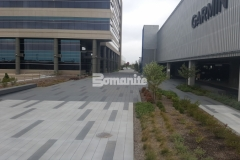 Bomanite Con-Color in Cobblestone Gray, Nickel Gray, and Natural Gray were combined here to create a custom color pattern on this Bomanite Sandscape Texture decorative concrete, adding beautiful visual appeal to the hardscape surface with the use of color, pattern, and texture.