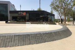 Installed alongside Bomanite Sandscape Texture and Alloy, Bomel Construction Company used a custom form liner to construct this Integral Gray, cast-in-place concrete wall at the LAFC Banc of California Stadium, adding unique textural detail to this art-inspired statement piece that serves as a focal point for park visitors.