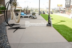 The hardscape walking paths and courtyards throughout COLAB Co-Housing feature Bomanite Sandscape Texture decorative concrete that offers variation in color and resembles sand blasted concrete to enhance the modern aesthetic throughout this stylish living community.