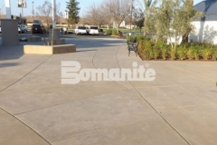 I love the stunning hardscape that was created here using Bomanite Sandscape Refined Antico decorative concrete because the architectural exposed aggregate and definitive saw cuts add visual interest and aesthetic appeal to the exterior gathering spaces at CrossCity Christian Church.