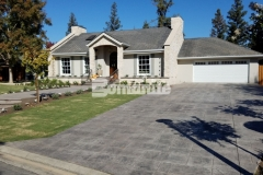 The front and back yards of this Fresno, California residence were beautifully transformed by our associate Heritage Bomanite and their use of Bomanite Imprint Systems and the English Sidewalk Slate Bomacron pattern to create the driveway, walkways, and back patio allowed them to enhance the old-world aesthetic while providing a durable, decorative concrete surface.