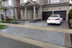 Our associate Bomanite Toronto installed this stunning stamped concrete driveway and front porch entrance for a Burlington, Ontario homeowner and their utilization of the Bomanite Bomacron Yorkshire Stone imprint pattern to create this charming and cohesive design won them the Silver Award in 2017 for Best Bomanite Imprint Project under 12,000 SF.