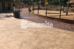 Bomanite Bomacron Regular Slate stamped concrete was expertly installed here by our colleague, Harrington Bomanite, to create durable pool decking around this water feature at Canobie Lake Park and add beautiful detail and dimension to the hardscape.