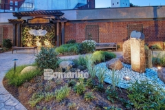 Featured here is Bomanite Bomacron imprinted concrete in both Small Sandstone and Regular Slate patterns and these meandering walkways were installed here to provide a durable and decorative hardscape surface that complements the tranquil, serene design aesthetic in this healing garden.