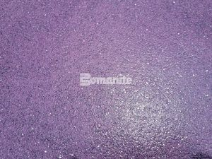 Bomanite Exposed Aggregate Systems using Bomanite Alloy in custom Harrisburg Mascot Purple close up.