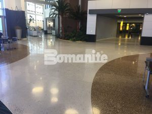 This decorative concrete floor in Bomanite Custom Polishing Systems is designed to look like a shoreline using Bomanite Renaissance and a winding shimmering middle area using Bomanite Modena Monolithic.