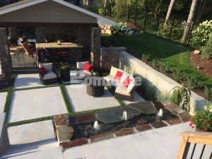 Looking down at the water feature, the main area, and the cabana of the Backyard Resort by Concrete Arts using decorative concrete and various Bomanite Systems.