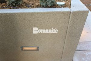 Close up view of planter wall using Bomanite Toppings Systems with Bomanite Micro-Top ST and Sandscape finishes at The Coloradan at Denver Union Station.