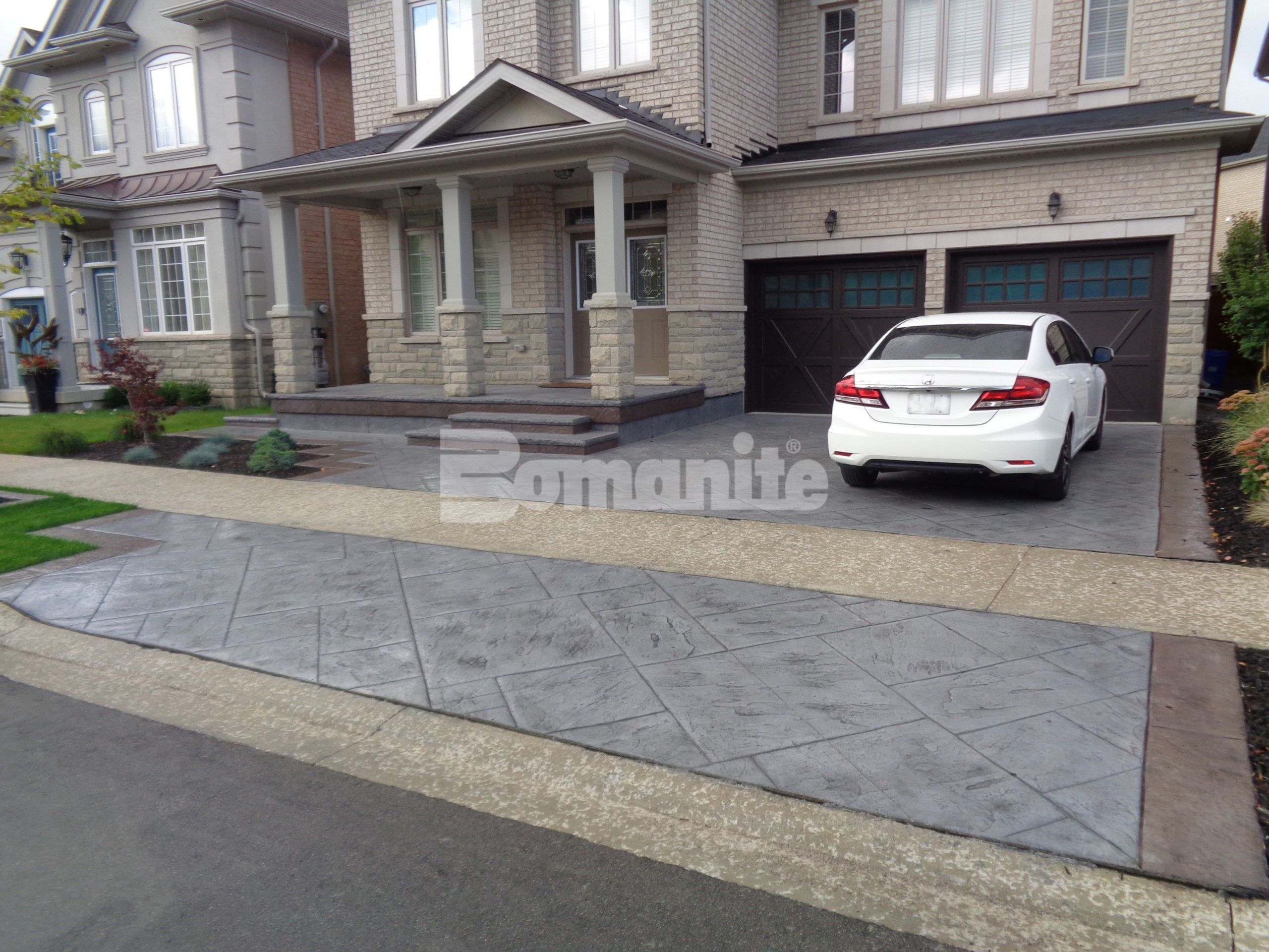 Bomanite Imprint Systems decorative concrete driveway, porch, and steps, using Yorkshire Stone Pattern with Bomanite Shale Gray Color Hardener installed at a residence in Burlington, Ontario, by Bomanite Toronto located in Vaughn, Ontario near Toronto Canada.